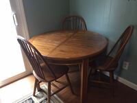Round brown wooden table with three chairs dining set Easton, 02356