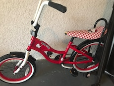 toddler's red and white bike