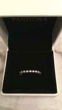 silver pandora ring with white case