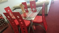 rectangular clear glass top table with four chairs