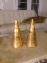 two brass-colored candle holders 39 km