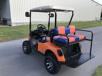 Nearly new orange Ez Go drive Electric golf cart cart.