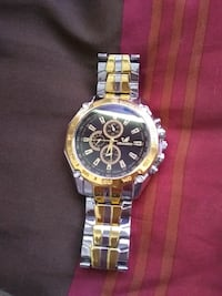 round gold chronograph watch with link bracelet Riverside