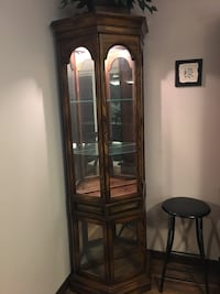 corner curio cabinet NEED GONE DUE TO MOVING
