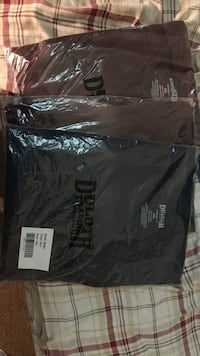 three black Duloth shirts with pack