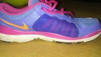 pair of purple-and-pink Nike running shoes