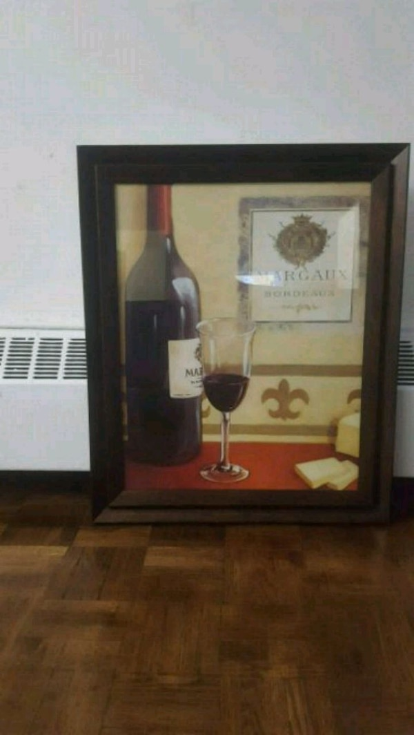 bottle and cup painting with brown frame