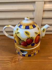 Teapot with tea light candle warmer