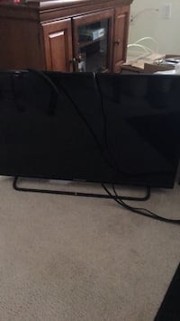 black flat screen TV with remote Columbia, 21045