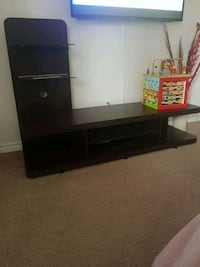 black wooden TV stand with flat screen television Edmonton, T5R 2R9
