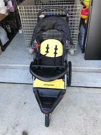 Baby's black and yellow expedition jogging stroller