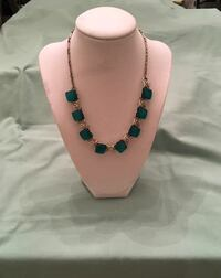 silver-colored and green stone necklace