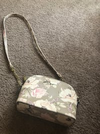 white and pink floral print bag
