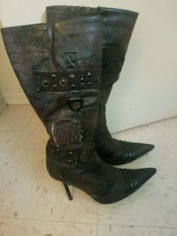 pair of black leather heeled boots