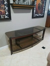 Tv center piece with glass shelving