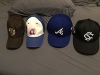 Four assorted fitted caps