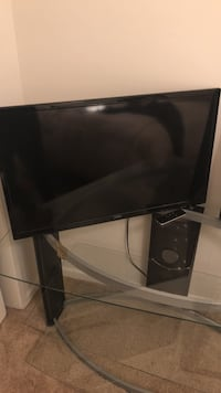 black flat screen TV with remote Long Beach, 90815