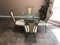 4 chair glass dining table