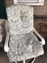White sturdy patio chairs and cushions