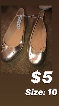 pair of brown leather flats Baltimore, 21239