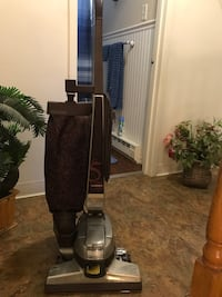 black and gray upright vacuum cleaner Rochester, 03867