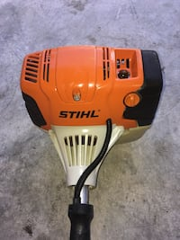 orange and black Stihl leaf blower