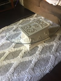 oval white concrete base glass-top coffee table