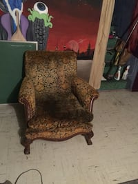 Brown and black floral fabric sofa chair