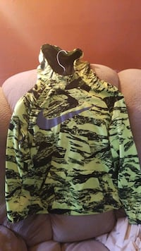 Neon green nike hoodie with 2 small stains