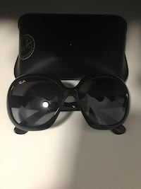 black framed Ray-Ban sunglasses 3494 km