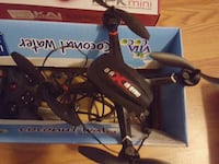 black and white quadcopter drone with box Chantilly, 20151