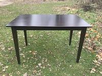 rectangular brown wooden table with black metal base Sandusky, 48471