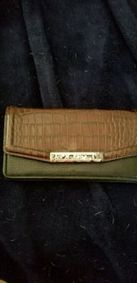 brown and green snakeskin clutch bag