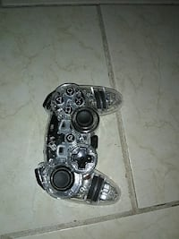 black and gray Sony PS3 controller