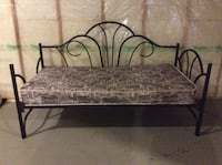 black metal bed frame with brown bed mattress Calgary