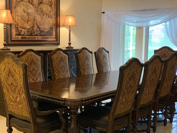 Large dining room table, chairs, and marble top buffet