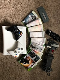 Xbox 360 console with controller and game cases Orlando, 32804