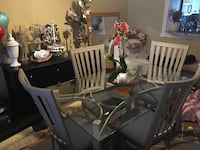 Glass dining table with four chairs (metal)