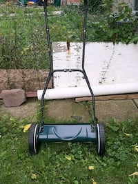 Manual lawnmower and weed feeder