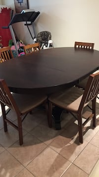 oval brown wooden table with four chairs dining set Terrebonne, J6V 0C1
