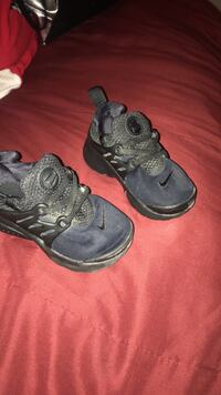 toddler's blue-and-black Nike Air Huarache-style shoes