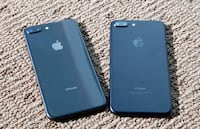 black iPhone 7 with blue case