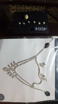 silver-colored chain diamond encrusted necklace with pack
