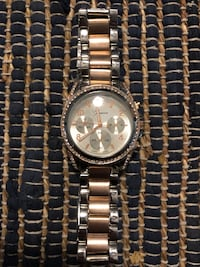 round silver chronograph watch with silver link bracelet Colleyville, 76034