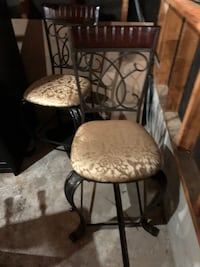 two black metal framed brown padded chairs King, L7B 0E8