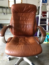 Brown leather rolling armchair
