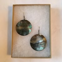 pair of women's round brown dangling earrings
