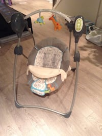 baby's gray and black bouncer