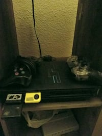 Ps2 console with wires, controller and games Longview