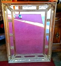 Antique heavy gold scrolled ornate mirror. 42 by 3 Arlington, 76001